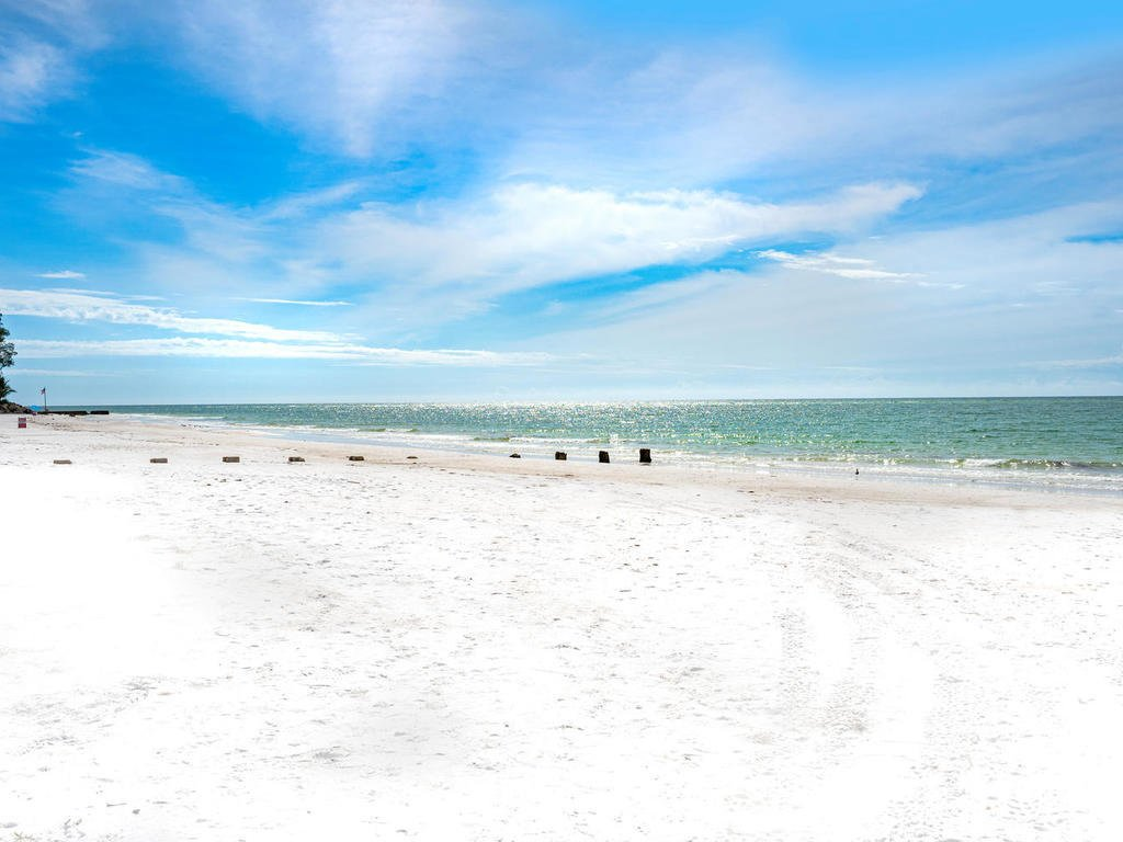 sandy hook neighborhood beach access to gulf of mexico  The Coach House