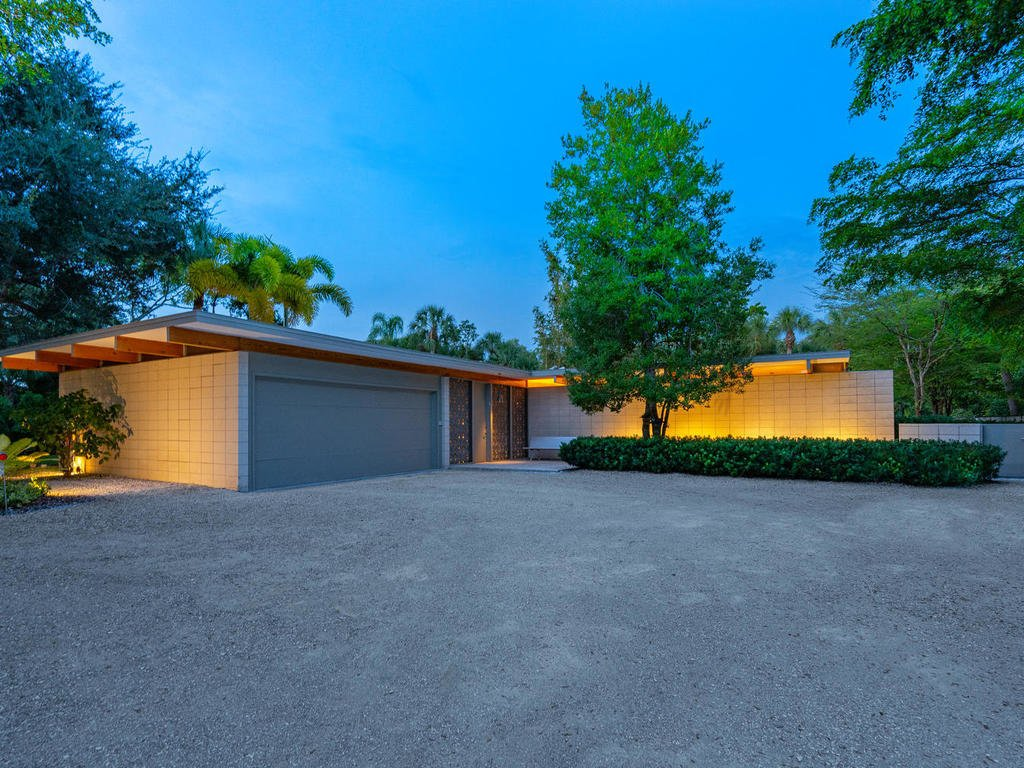 front, evening, showing stacked ocala block, clerestory windows and beams through home, sarasota school of architecture - seibert architects mid-century modern traits  The Coach House