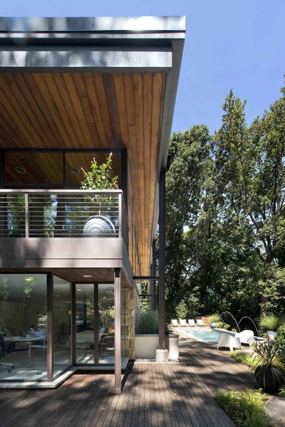 Exterior Side View with Outdoor Pool and Patio