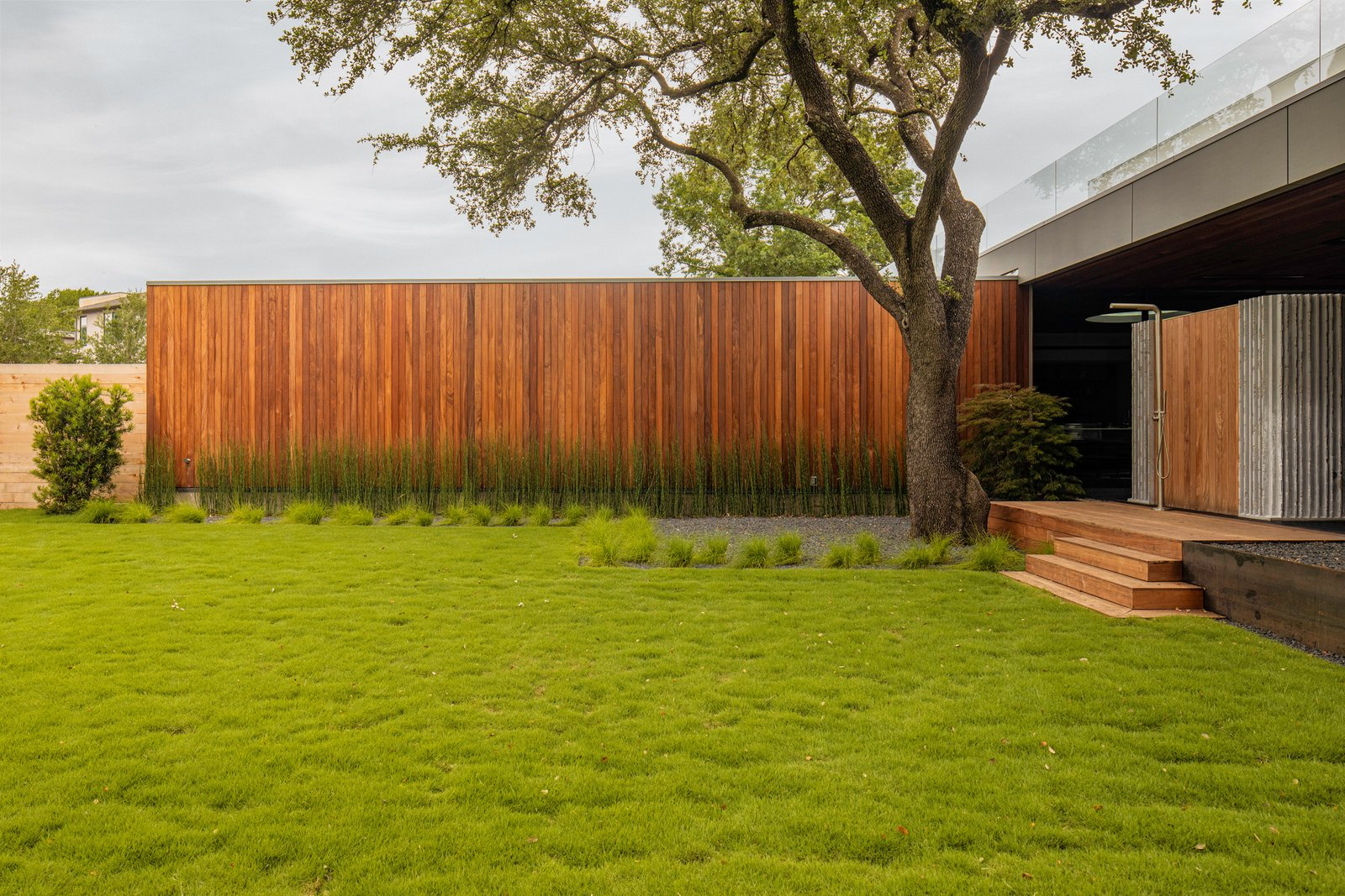 Exterior, Flat RoofLine, Wood Siding Material, and House Building Type Taula House by M Gooden Design  |  Garage  Taula House by M Gooden Design