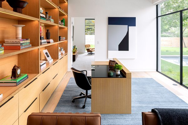 The serene home office of Taula House by M Gooden Design gazes out onto the backyard.