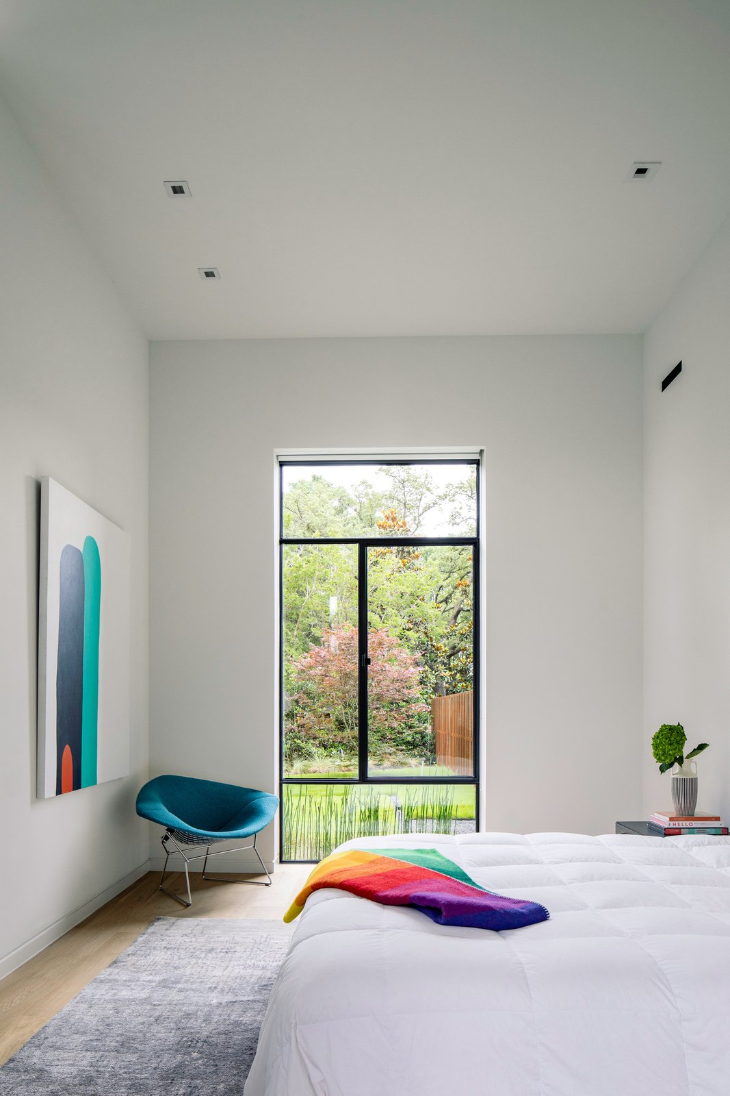 Bedroom, Recessed Lighting, Chair, Light Hardwood Floor, and Bed Taula House by M Gooden Design  |  Guest Room  Taula House by M Gooden Design