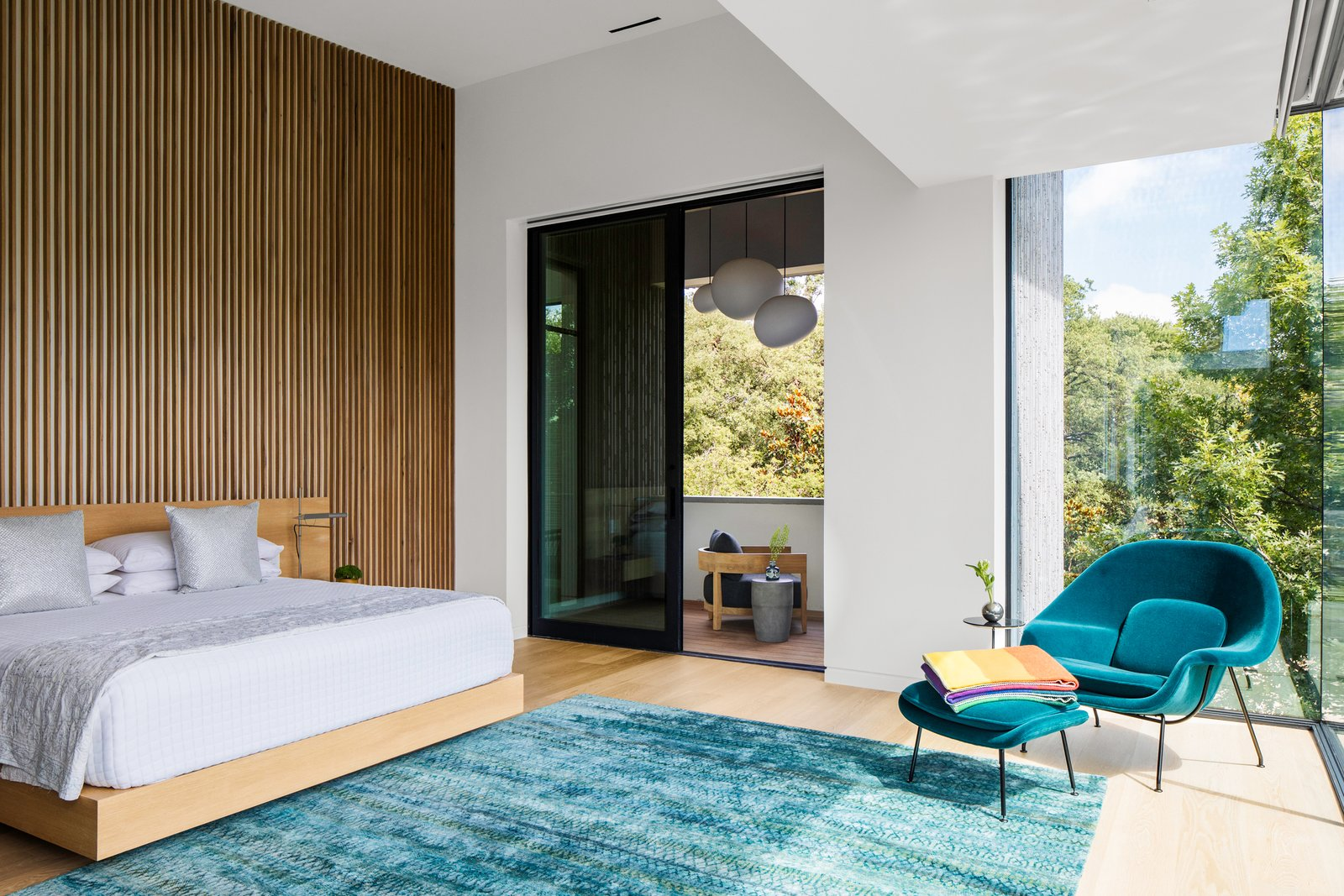 Bedroom, Bed, Light Hardwood Floor, Recessed Lighting, and Chair Taula House by M Gooden Design     Master Bedroom  Taula House by M Gooden Design