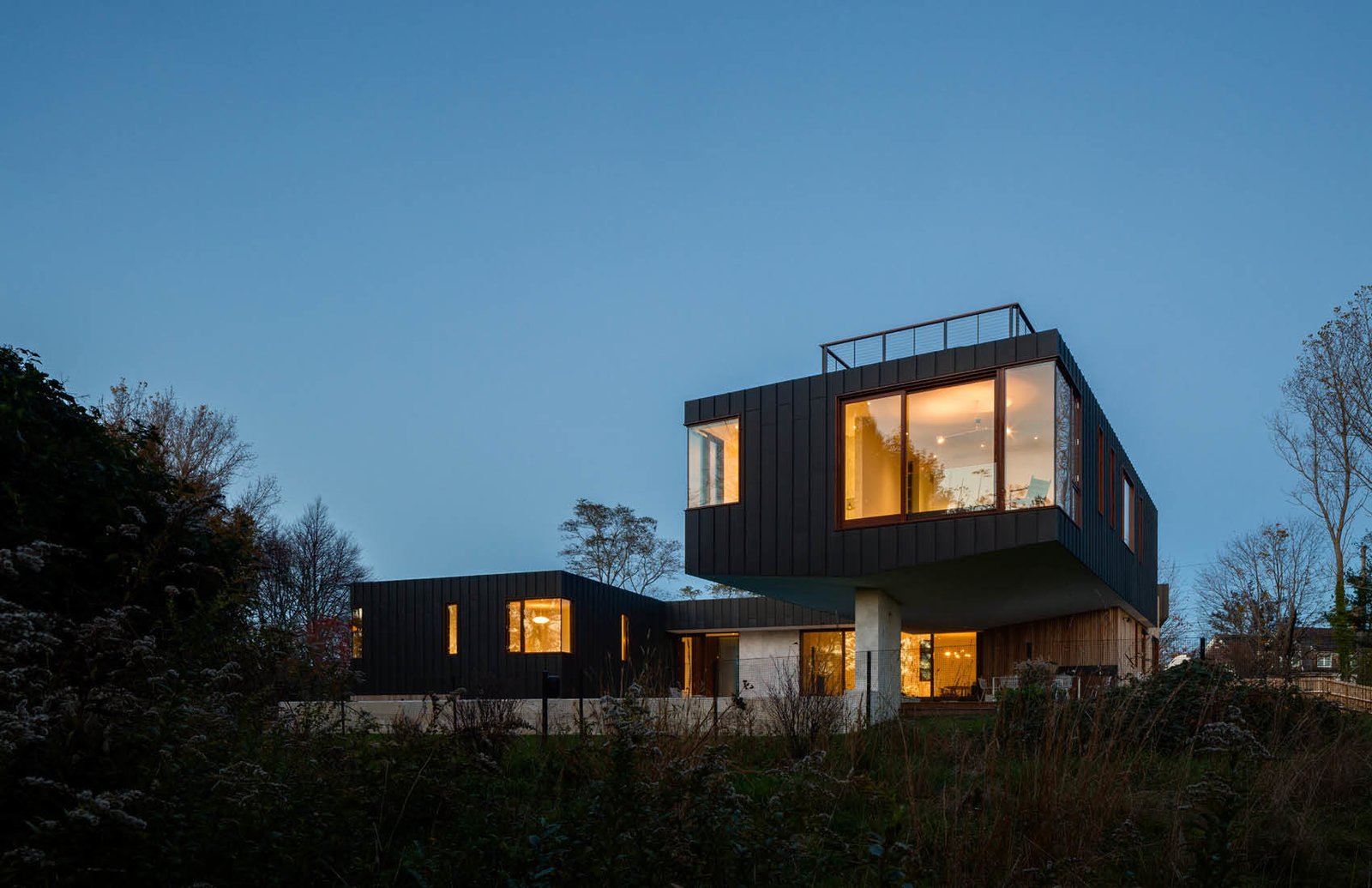 Rear of the House hovering over the wetlands.  Watermill House by Office of Architecture