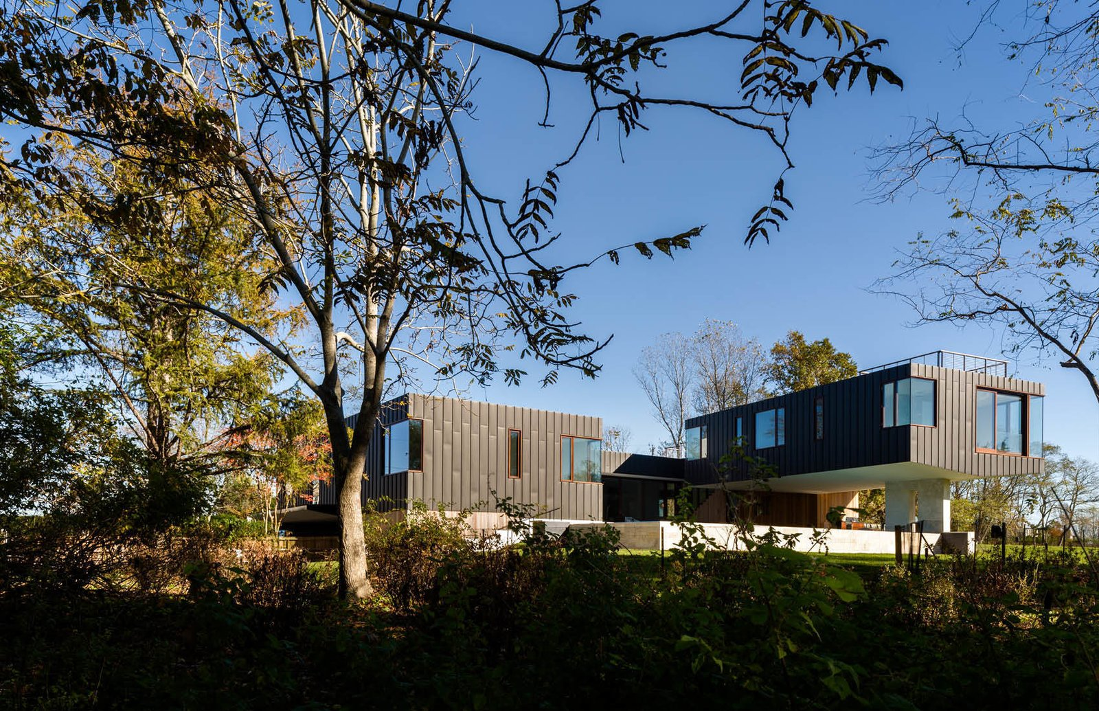 Rear Facade overlooking the wetlands  Watermill House by Office of Architecture