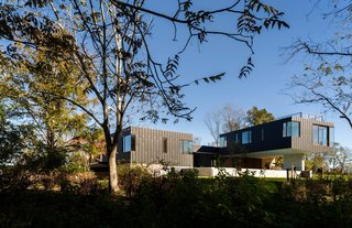 Lifted high above the property, the cantilevered family wing is supported by two large columns.