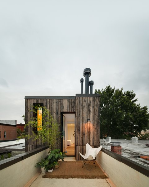 The added top floor houses the master bedroom and bath, as well as a rooftop terrace.