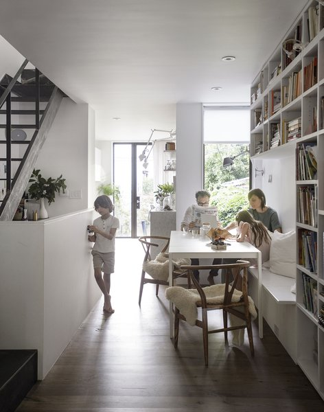 The first floor is a continuous public space featuring a dining area, kitchen, and living room.
