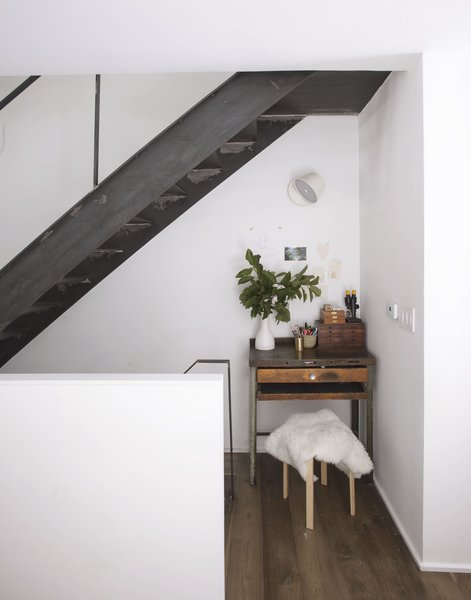 """Some of my favorite spaces are those that weren't even necessarily planned,"" says Shahane. ""For instance, underneath the stair on the first floor it ended up being a few inches deeper than initially planned because of plumbing requirements. But those inches made a perfect and impromptu alcove for our daughter's drawing table."""