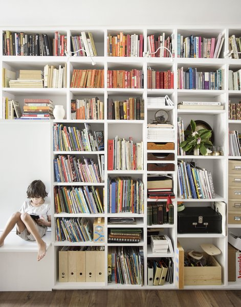 Floor-to-ceiling bookshelves provide ample storage for books and memorabilia.
