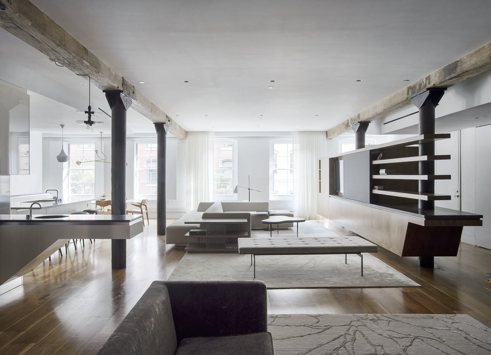 Living Room, Bookcase, Sectional, End Tables, Bench, Medium Hardwood Floor, and Sofa East View  Tribeca Loft by Office of Architecture