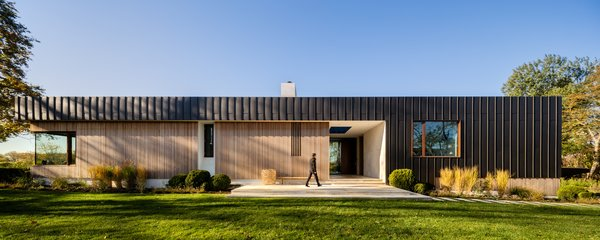 Taking advantage of the sloping site, the architects designed the three-level Watermill House to appear as a single-story home from the street.