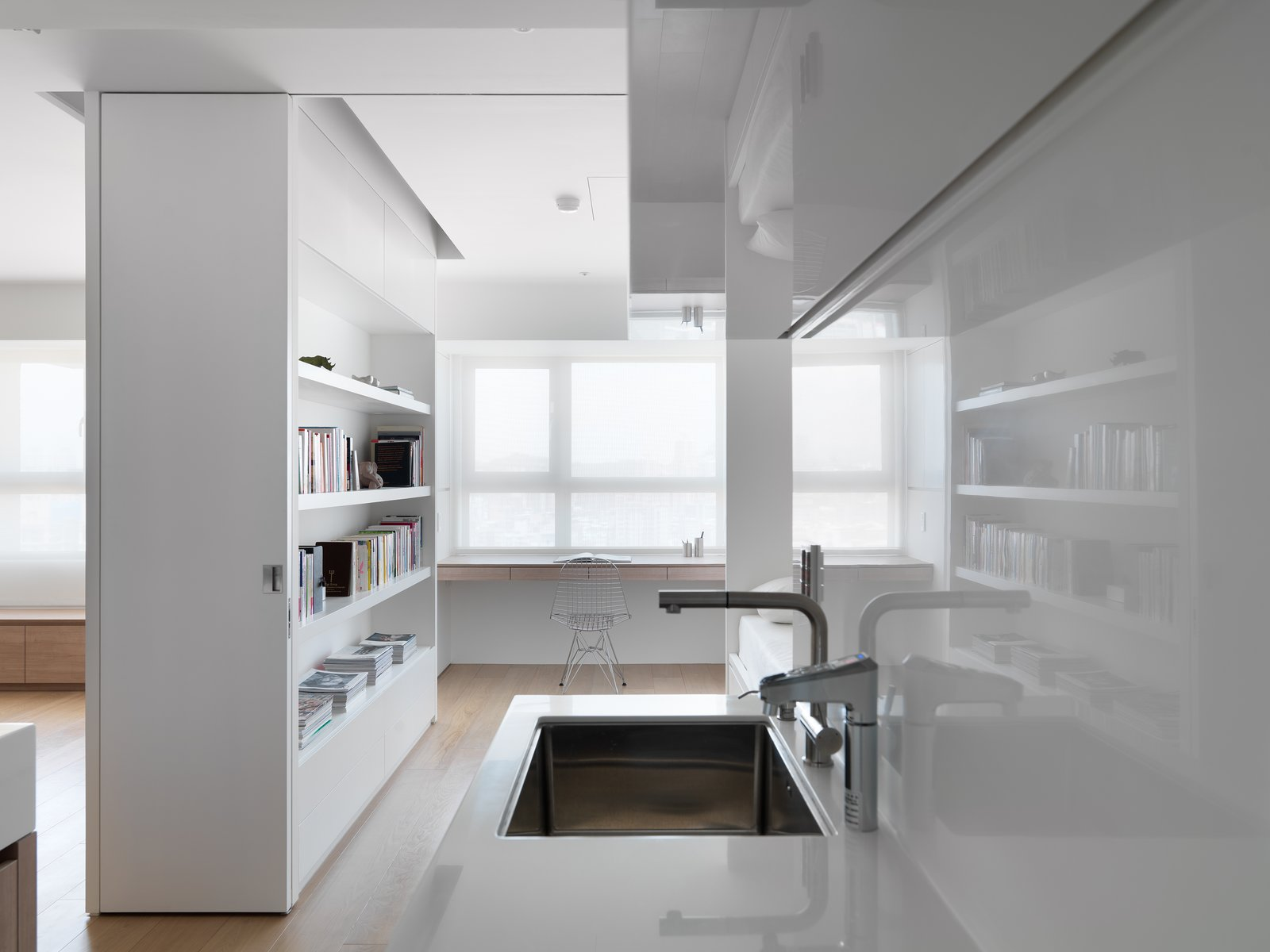 The surface of materials are chosen to meet function, and also add reflection or depth for the space.  KT Apartment by Marty Chou Architecture