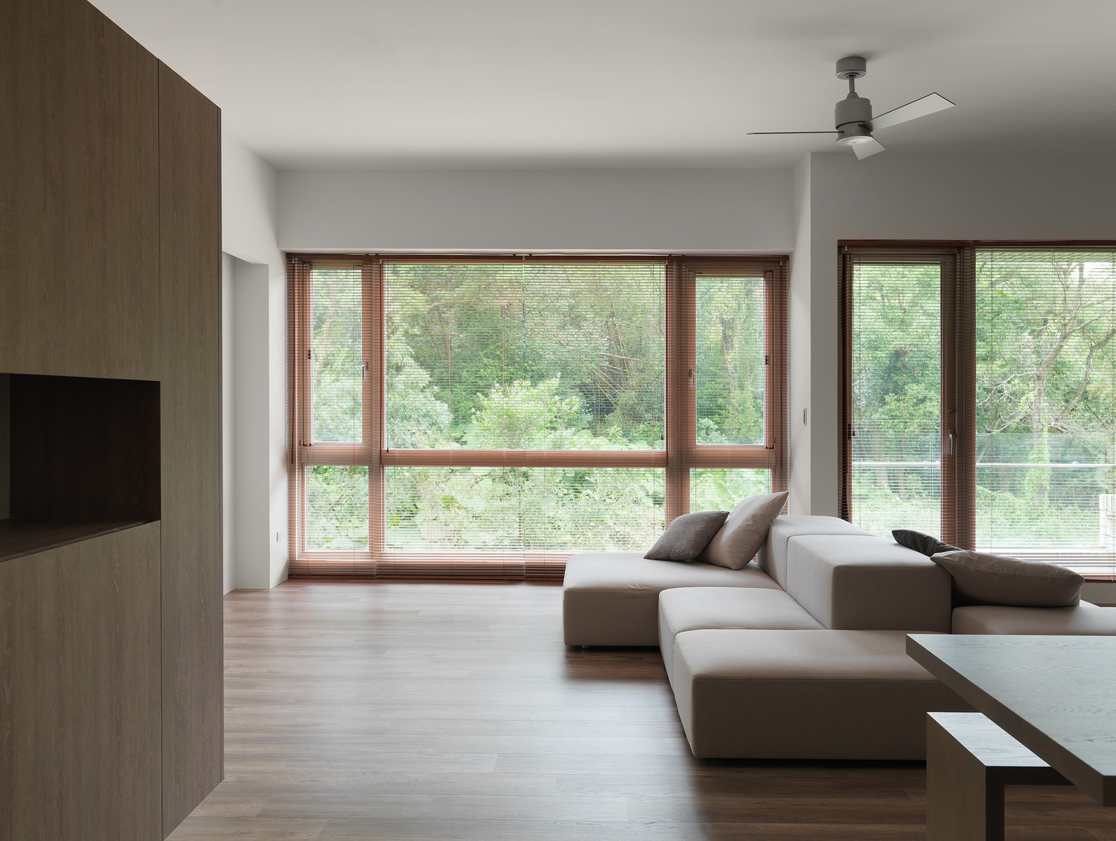 Living space with lush forest view.  H Residence by Marty Chou Architecture