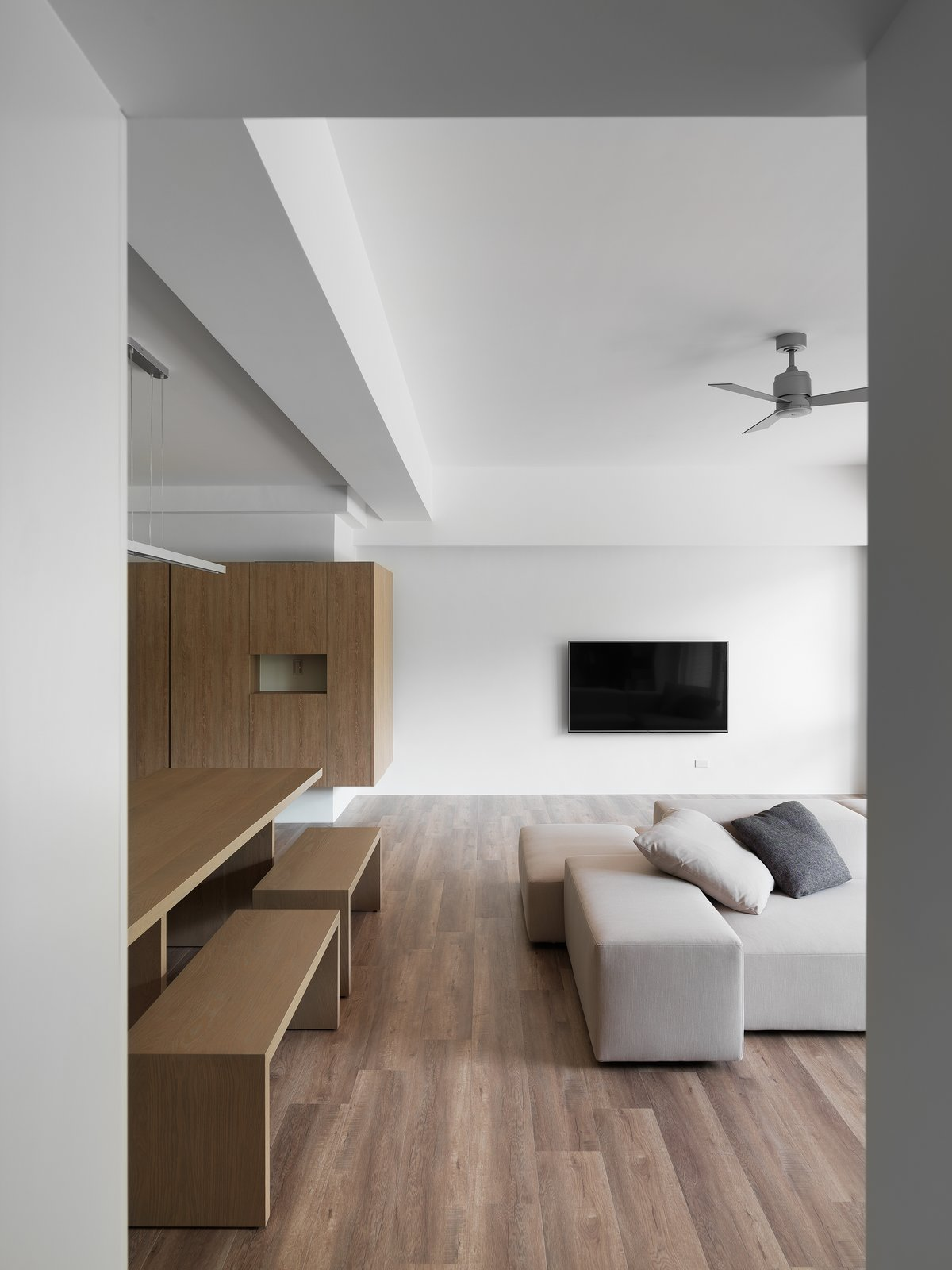 View of living space through the corridor.  H Residence by Marty Chou Architecture