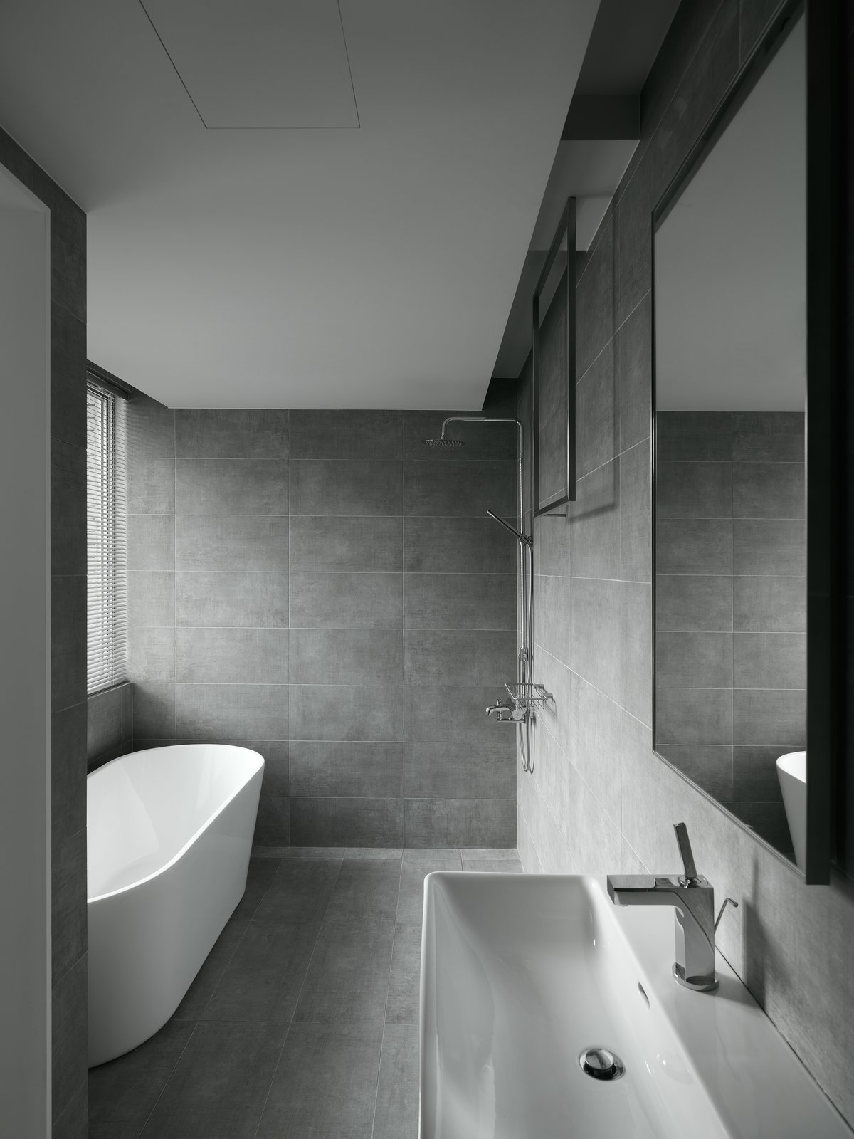 A cave-like master bathroom in response to the natural surrounding of the outside.  H Residence by Marty Chou Architecture