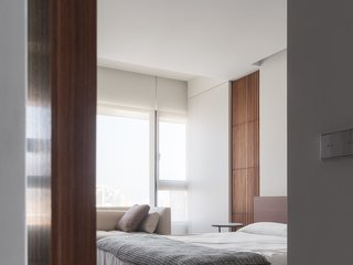 A glimpse of master bedroom, with movable wall hides away the secret balcony.