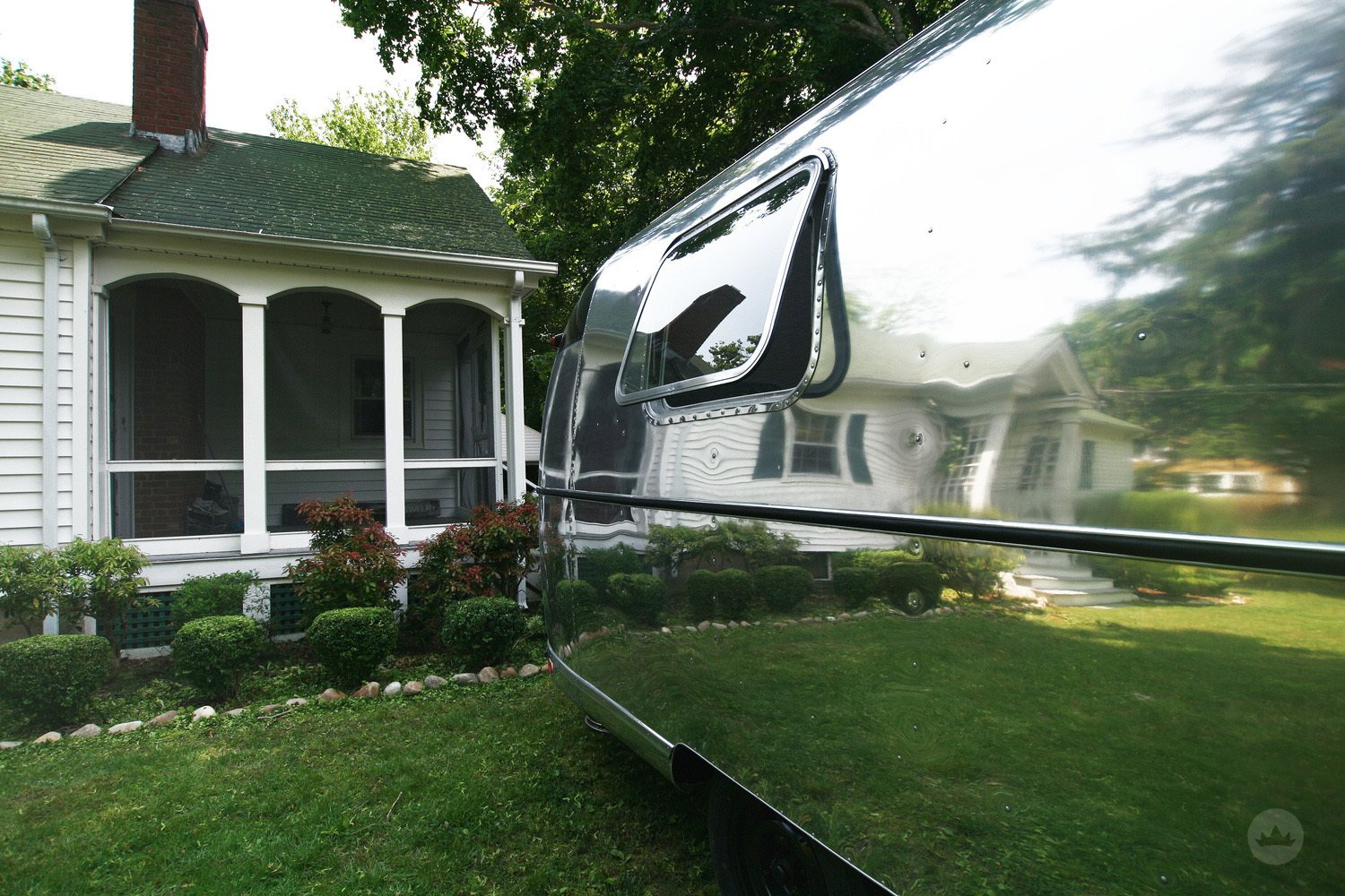 Airstream Building Type, Metal Roof Material, Metal Siding Material, and Curved RoofLine Gogo, Exterior / She sits just outside of a beautiful home in Shelter Island reflecting her surroundings.  Gogo, the 1974 Argosy by ESK Productions & Design