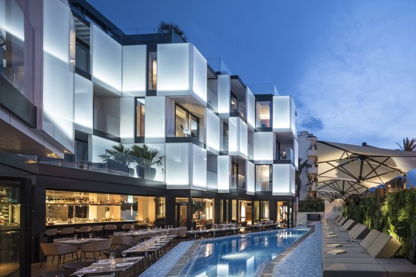 Barcelona-based architecture firm Ribas & Ribas shaped the hotel's modern checkerboard exterior in a way that echoes the surrounding marinas and natural landscape, while Baranowitz +Kronenberg designed the hotel's interiors to be an homage to the island's legacy as a decadent, bohemian holiday destination with maritime roots.