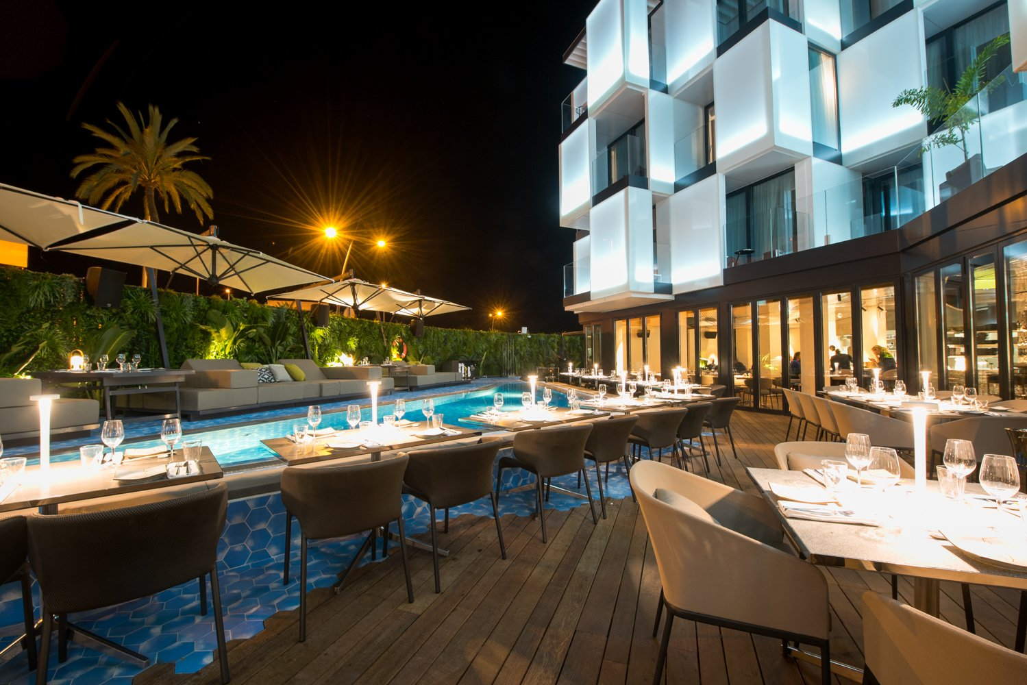 Outdoor, Decking Patio, Porch, Deck, Swimming Pools, Tubs, Shower, Wood Patio, Porch, Deck, and Large Patio, Porch, Deck Opened in July 2017, Sir Joan is the first Sir Hotel property to operate in Spain. The 38-room hotel is situated in the center of Ibiza, overlooking the historic town center and neighboring ports.   Photo 2 of 11 in A New Hotel That Celebrates Ibiza's Maritime History and Love For Parties