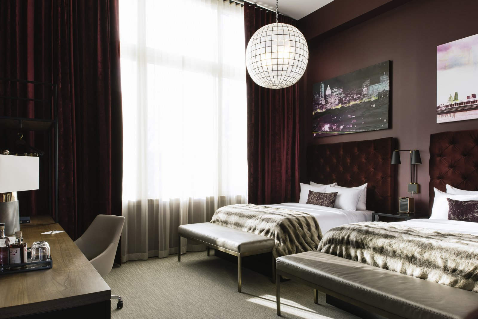 Bedroom, Chair, Night Stands, Bed, Bench, Wall, Pendant, and Carpet Sleek, stylish vibes await guests in the rooms at Hotel Covington.  Bedroom Carpet Night Stands Pendant Bench Photos from This Group Is Reimagining the Future of Boutique Hotels