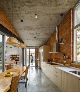 Brick, paired with concrete and wood, creates an organic warmth throughout this Spanish home.