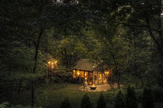 Located in the hills of southern Wisconsin, the Glass House cabin provides a panoramic view of the surrounding woods.