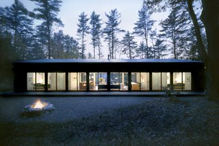 Nestled on a private six-acre lot in New York's Hudson Valley, this glass cabin was designed by INC Architecture & Design.