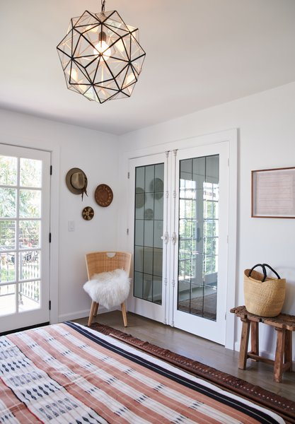 The newly installed closet doors are custom made. Unique details, like the cremone bolts attached to the leaded glass doors, create an extra layer of character in the room design.