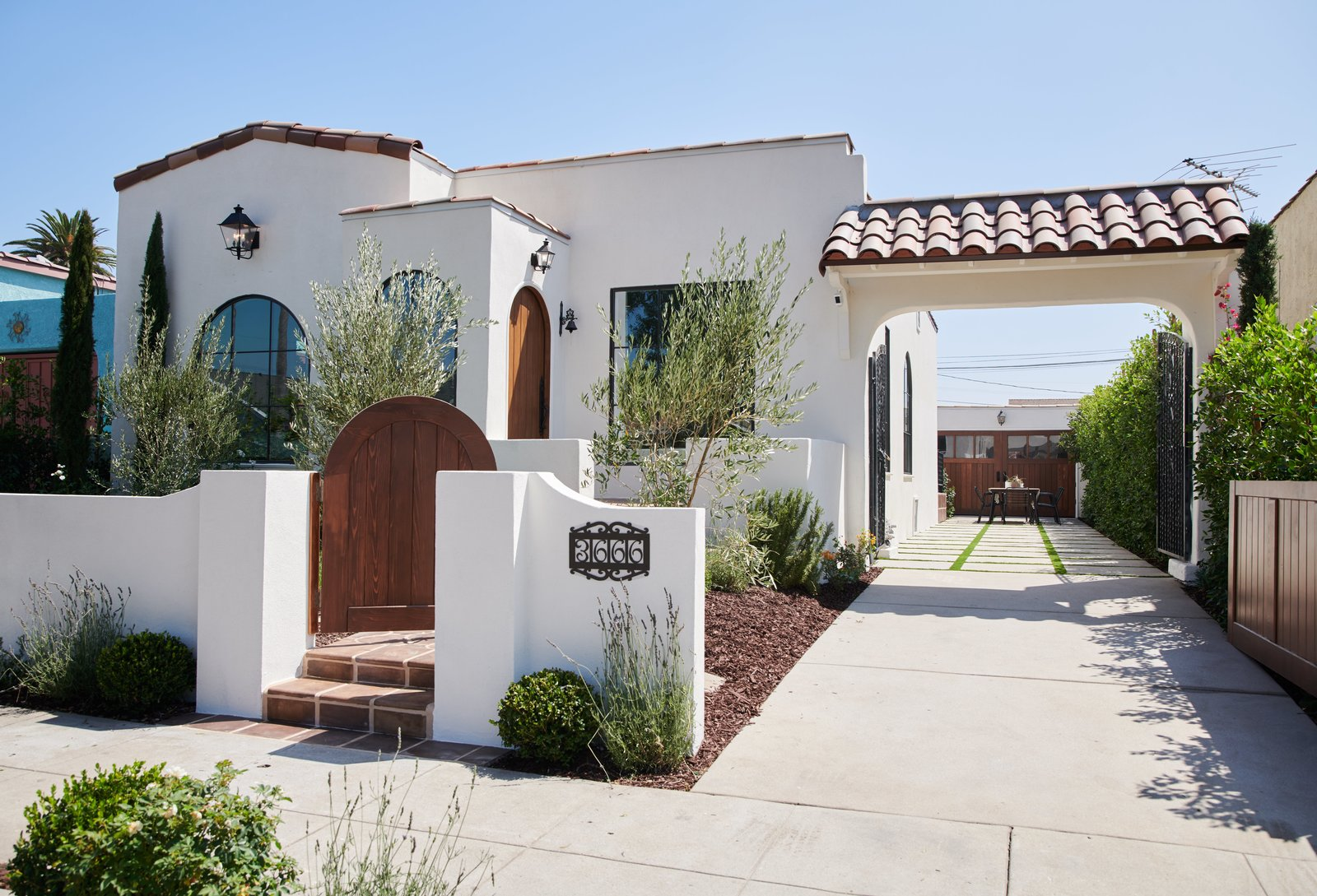 the renovated exterior features fresh landscaping and hardscaping along with new windows and doors