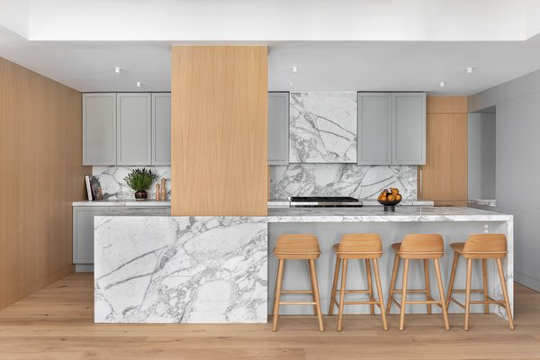 "The Stewart-Schafer team hand-selected each slab of Calacatta Vagli marble to be book-matched. ""We love the beautiful natural veining and imperfections of marble against the clean lines of the kitchen design,"" noted Stucker.  To protect the marble, they used a trade secret sealing product that comes with a lifetime guarantee, which, according to Stucker ""helps alleviate the hesitations some clients have with marble."""