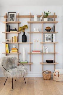 Veal and Stucker created a stylish and functional reading nook off of the living room, complete with a custom shelving unit.