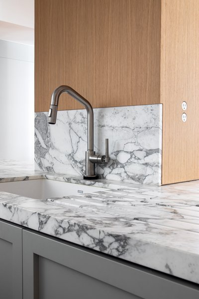 """The combination of the materials makes for a contemporary yet timeless kitchen that will last a lifetime. We aim to design kitchens that not only look good but are made to stand the test of time."" — Christine Stucker"