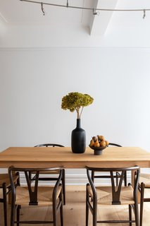 Organic shapes and natural materials create a dining vignette that is simple yet stylish.