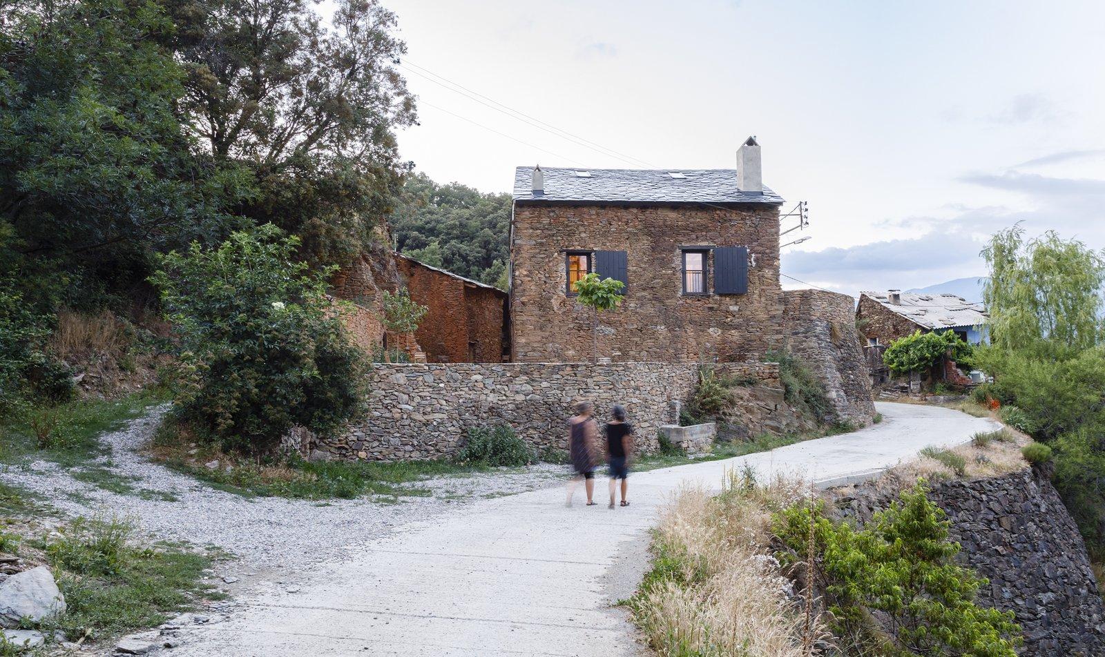 Can Castellnou by Acabadomate stone farmhouse exterior