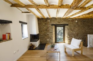 The original stone walls and wood ceiling beams were cleaned and restored to their natural finish.