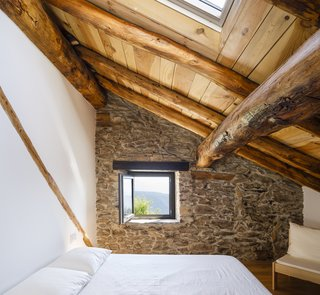 New windows and skylights were added for natural light and ventilation, opening up the bedrooms to the surrounding mountain views.