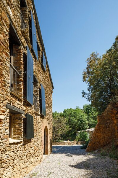 The original stone facade of the farmhouse was left intact to preserve its rural character.