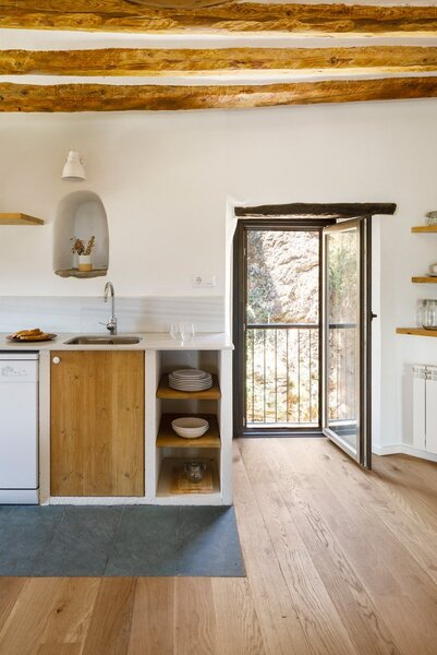 Alcoves and open shelving in the kitchen allow dishware and other accessories to be on display.
