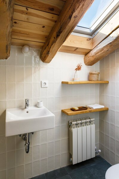 Modern bathrooms were installed using natural materials and simple fixtures.