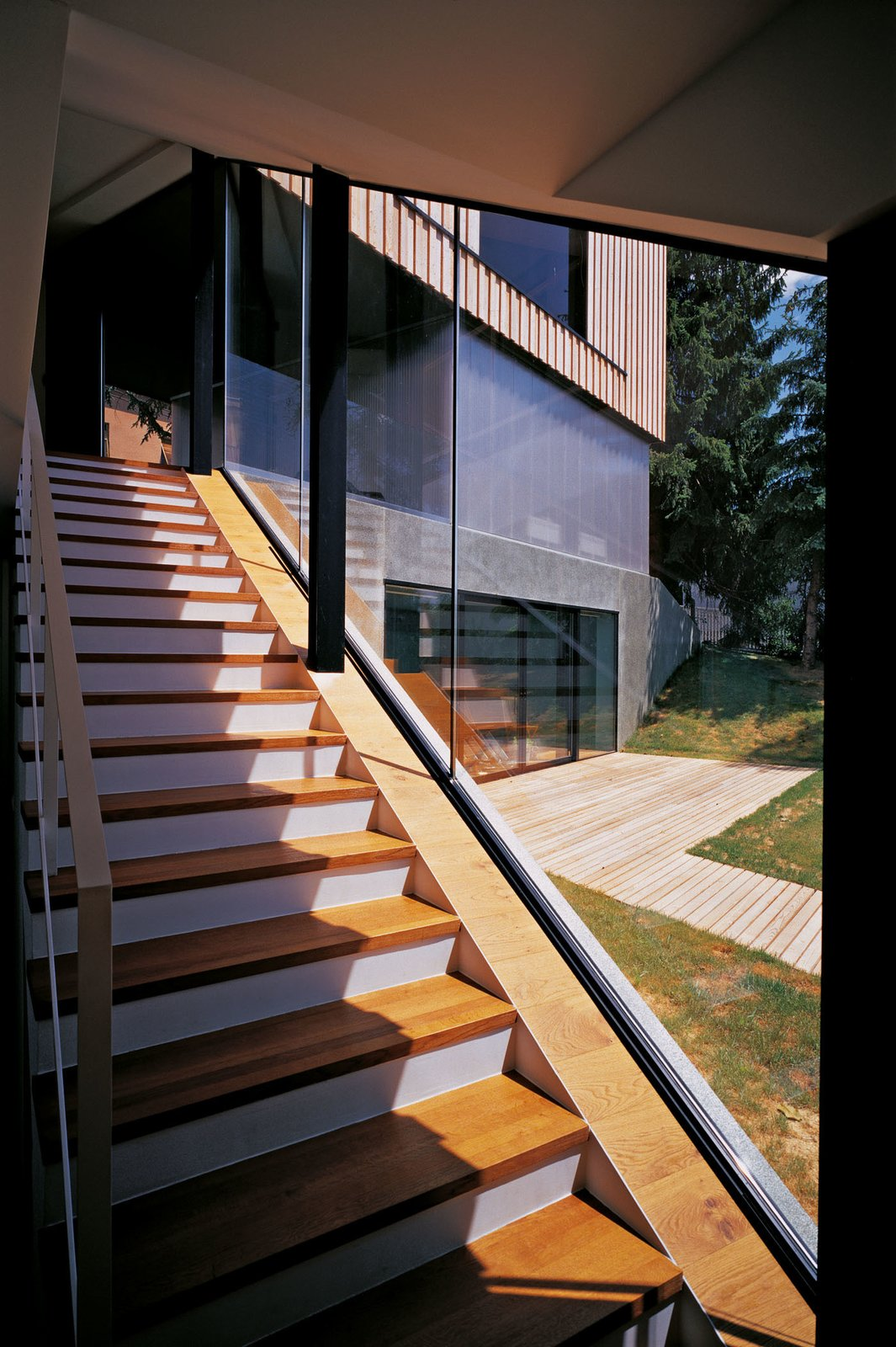 Stairs that connect the ground floor and basement floor  House J2 by 3LHD