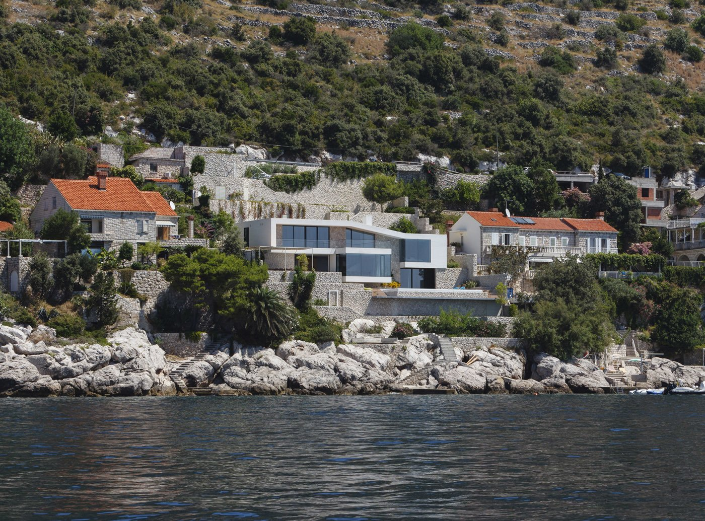 View of the house from the sea  House V2 by 3LHD