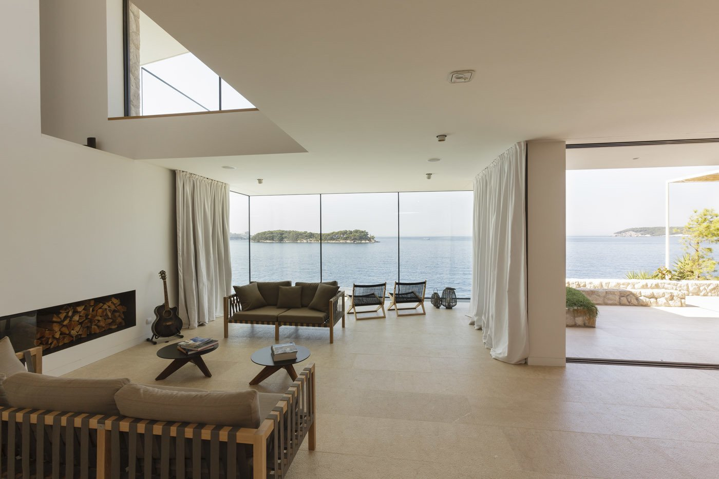 Living room and the view of the sea  House V2 by 3LHD