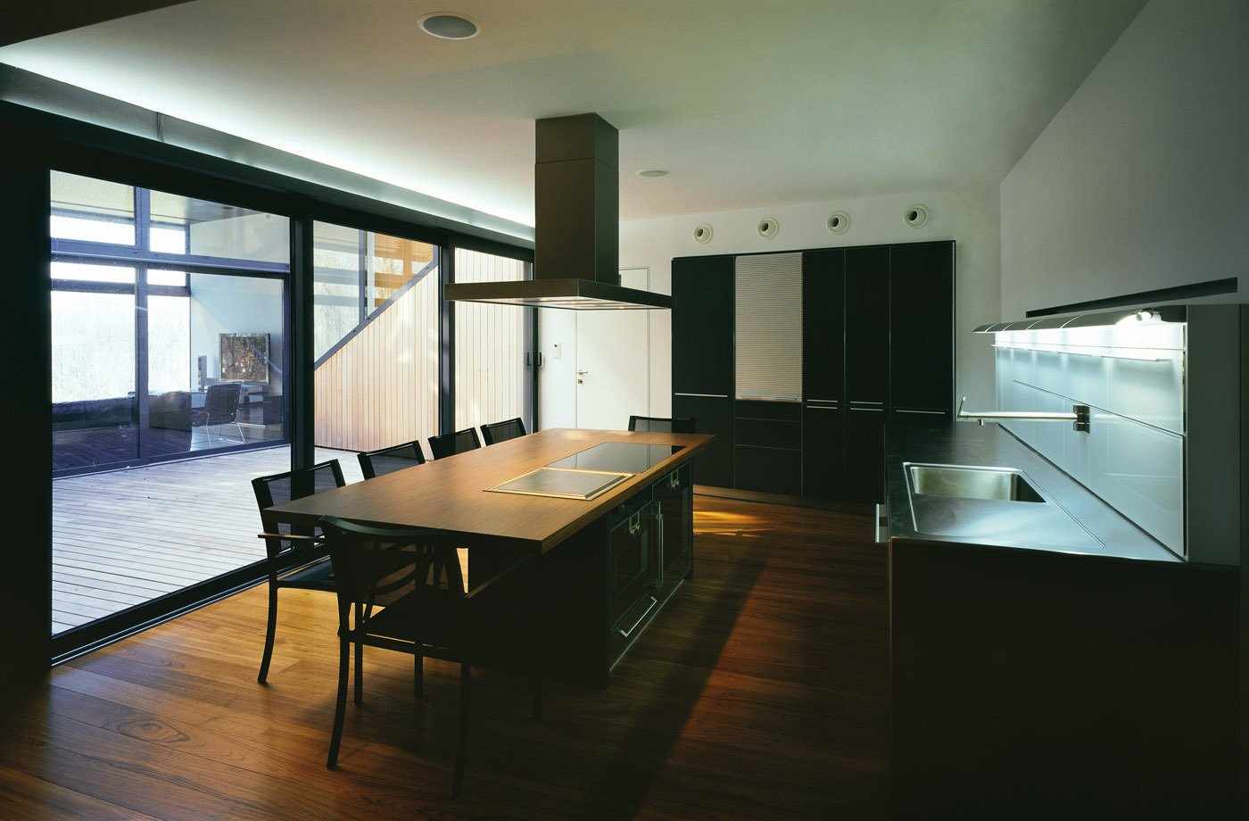 Kitchen and dining room with a view of the atrium  House K by 3LHD