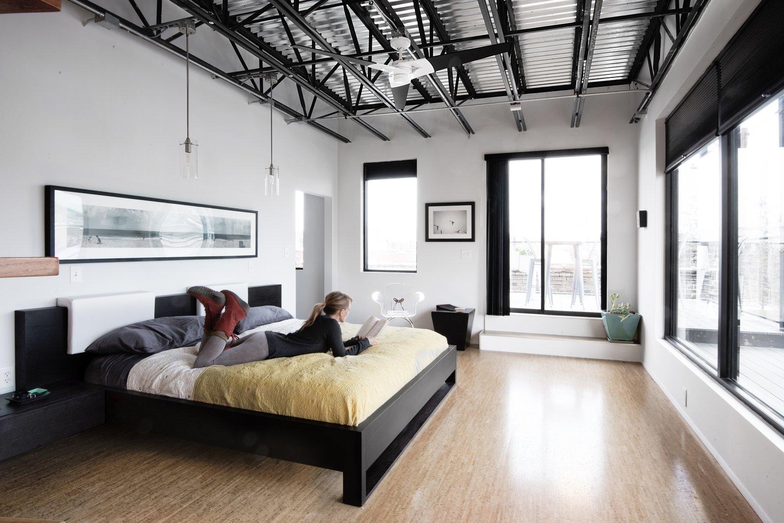 Master bedroom opens onto wrap around balcony terrace.  Studio GoodLight by Liesa Cole