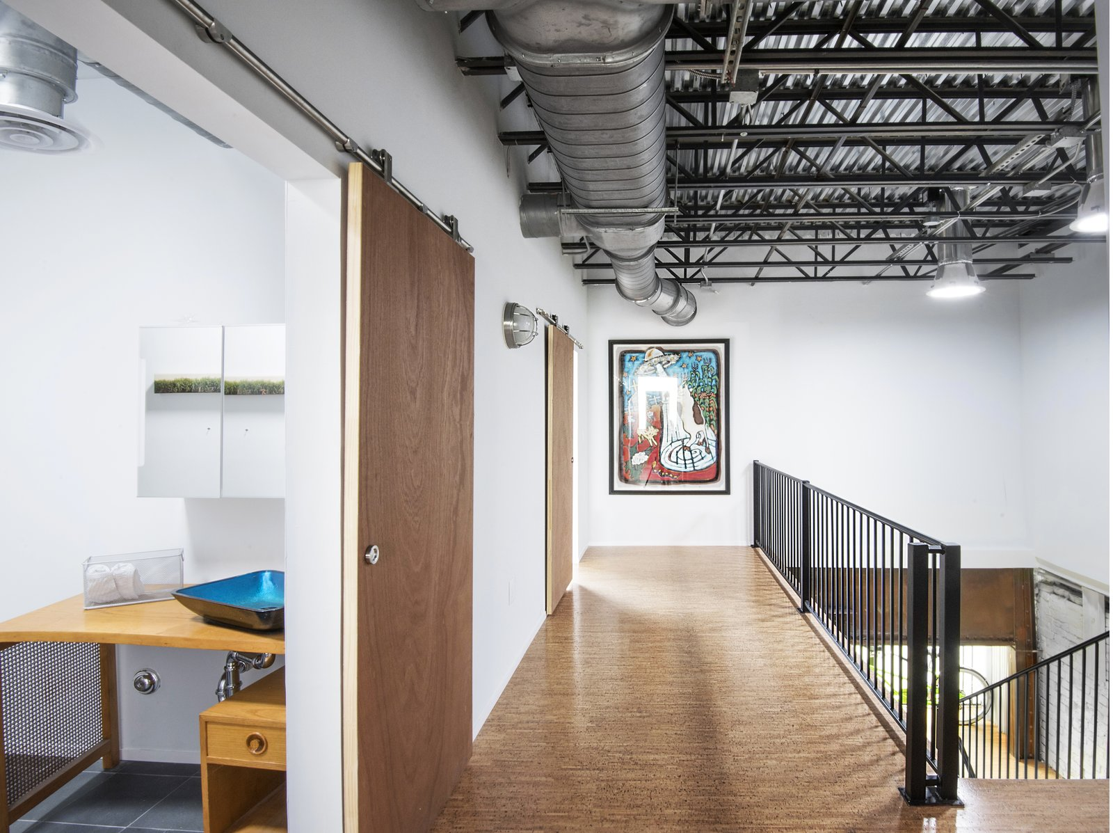 guest bath, residence hall, stairwell, exposed ceiling throughout residence, solatube provides natural light.  Studio GoodLight by Liesa Cole