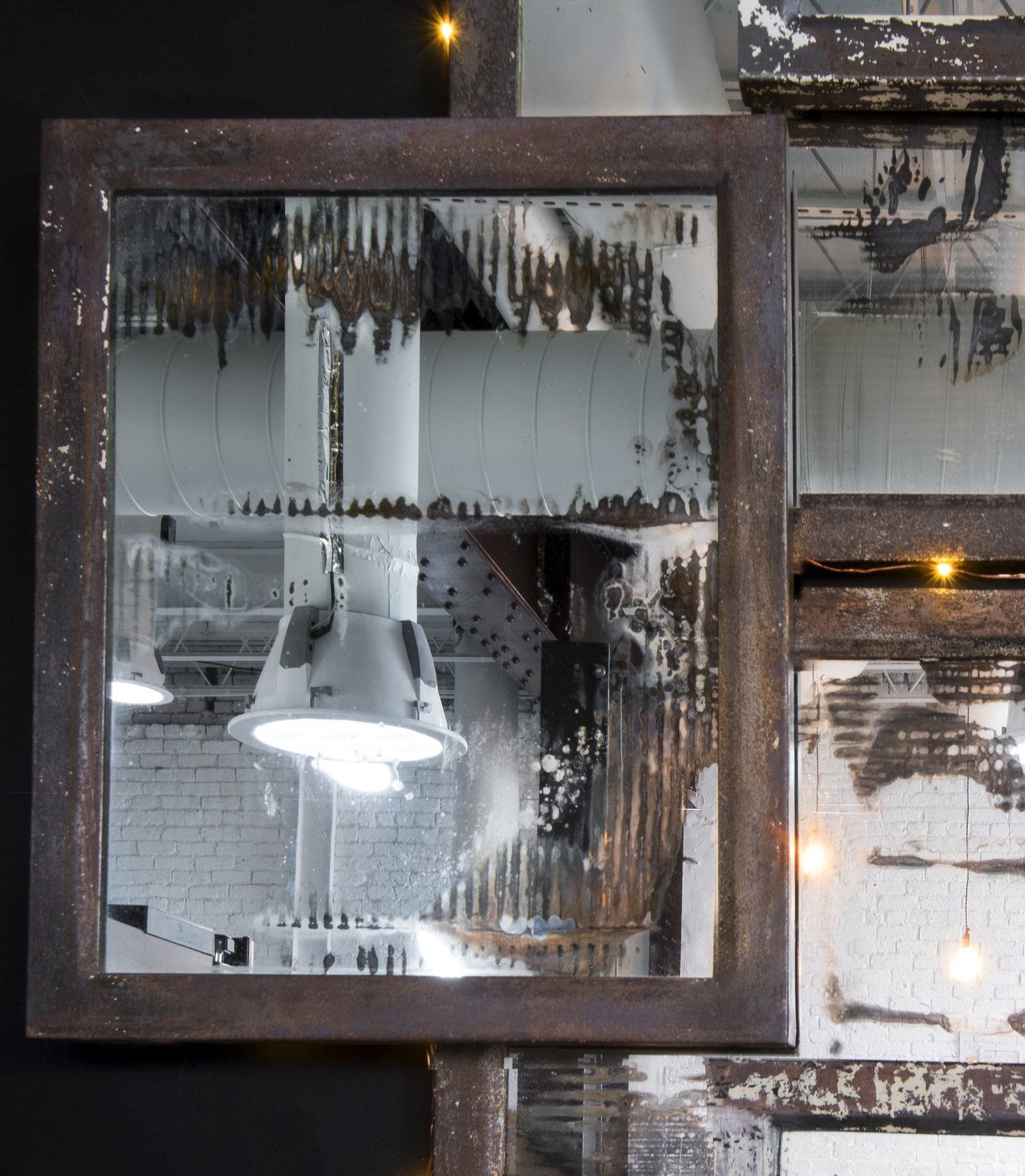 Detail of vintage mercury mirror installation made from medicine chests collected from historic Birmingham Hotel renovation.  Made by the Funktion Art Design Compound, a local collective that up-cycles and re-imagines architectural accents.  Studio GoodLight by Liesa Cole