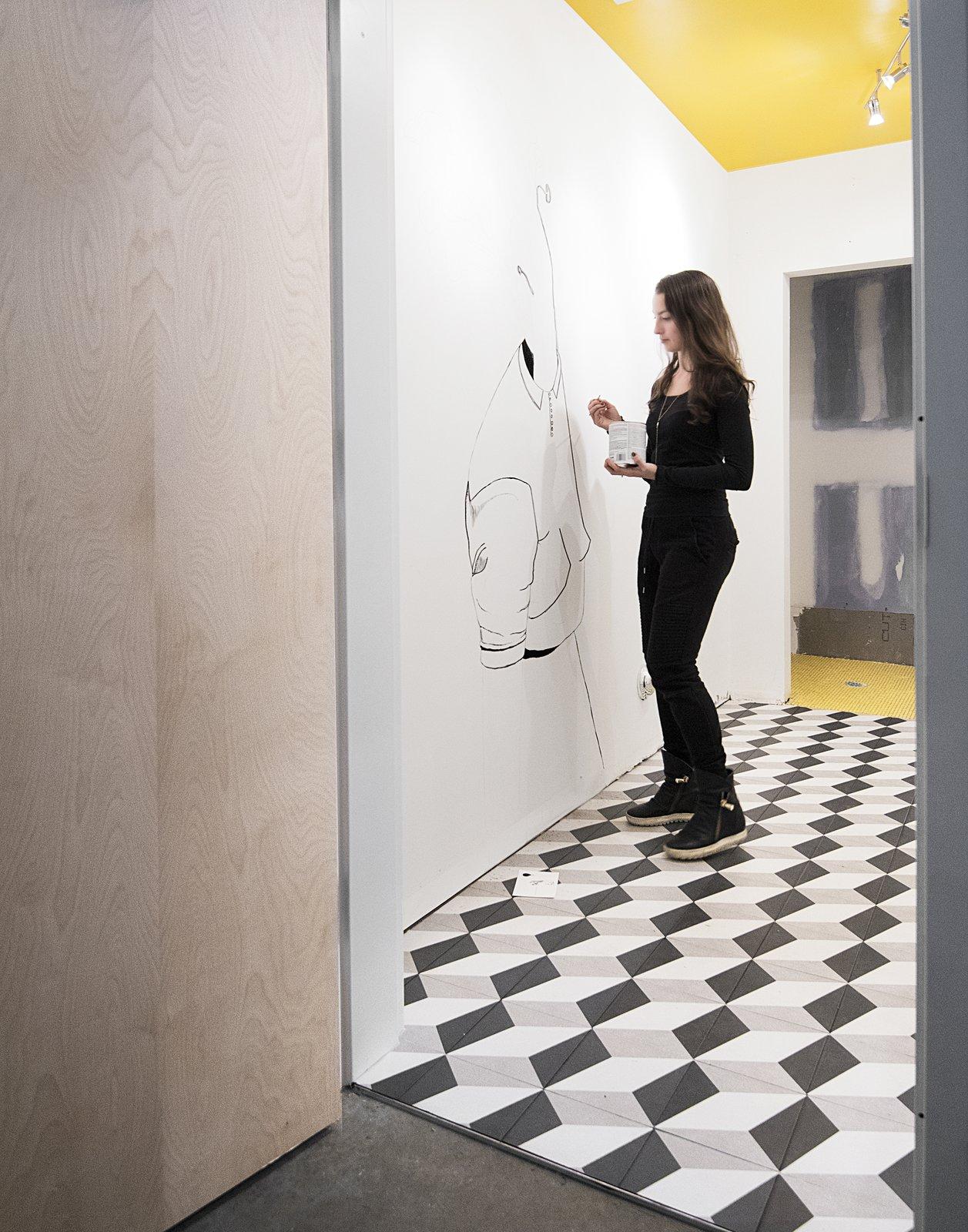 artist Gabrielle Bates Stahlman (Liesa Cole's daughter) painting a poetry comic mural in the studio bathroom  Studio GoodLight by Liesa Cole