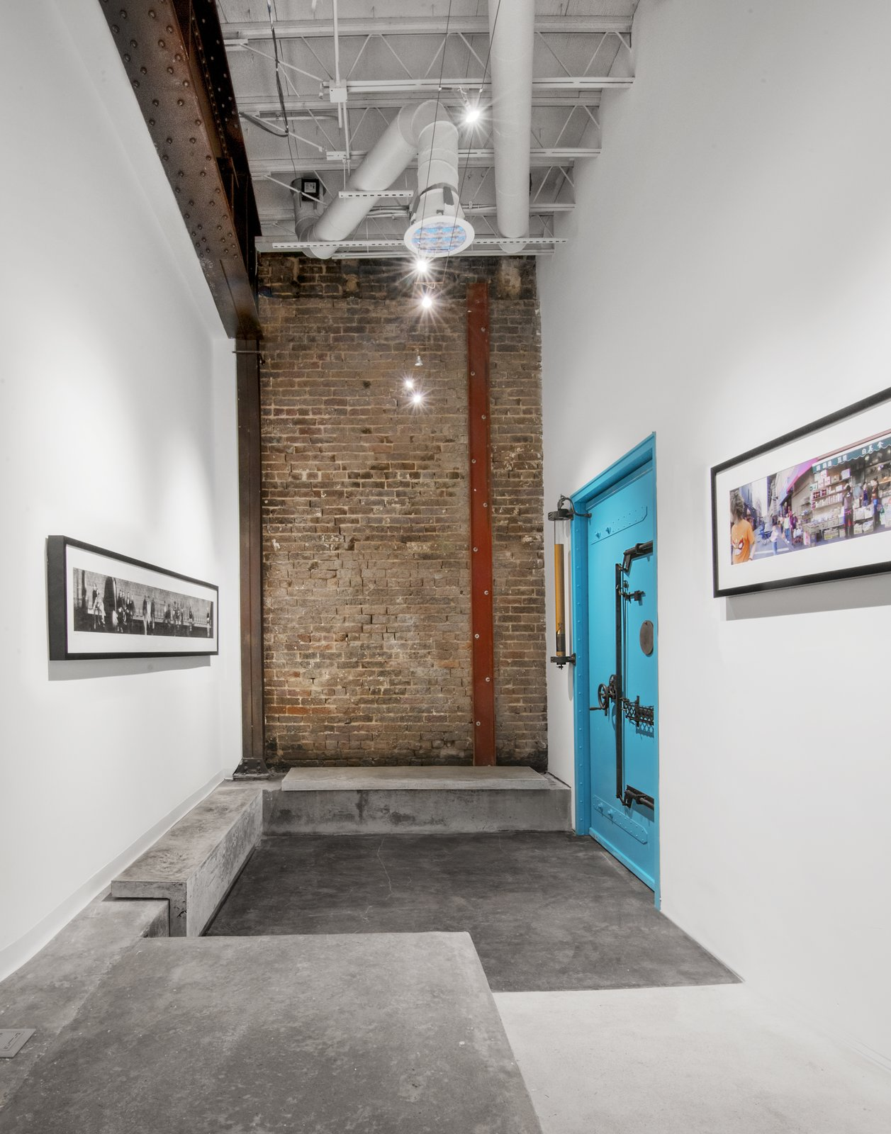 Studio lobby featuring cast concrete benches with seat impressions by Jan Jander  Studio GoodLight by Liesa Cole