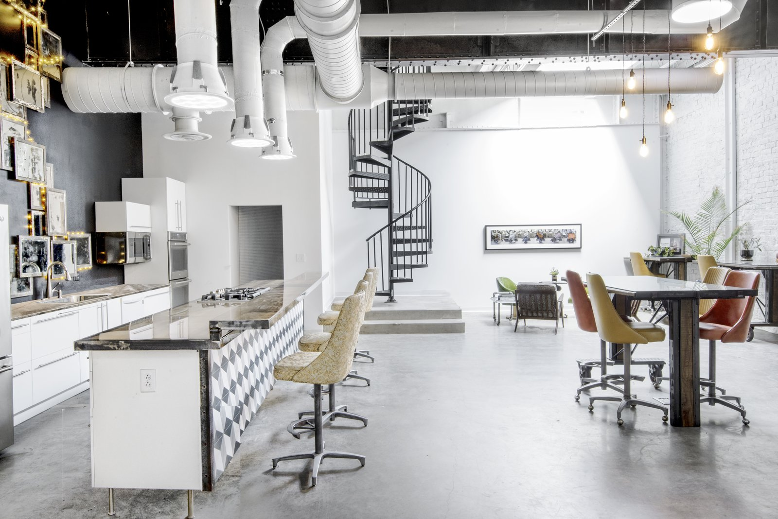 Studio kitchen/bar area, conference and work stations. Furnishings include vintage Chromecraft swivel chairs converted to barstool height.  Studio GoodLight by Liesa Cole